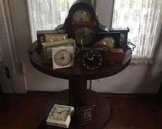 victorian library table with claw feet,vintage clocks