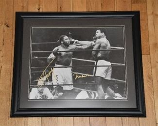 Muhammad Ali and Joe Fraser double autographed 16x20 fight photo with authenticity.