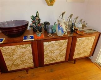 MCM Credenza with reversible front panels to solid wood.