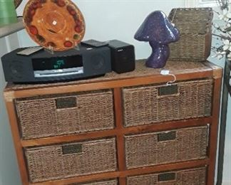One of several wicker storage units, retro handpainted ceramic mushroom and Bose radio/ cd player.