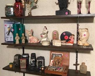 Vintage cameras, vintage eye glasses, vases