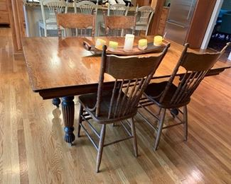 """10. Set of 4 Antique Carved Oak Side Chairs 11. Antique Oak Dining Table w/ 2-12"""" leaves (45"""" x 45"""" x 30"""")"""