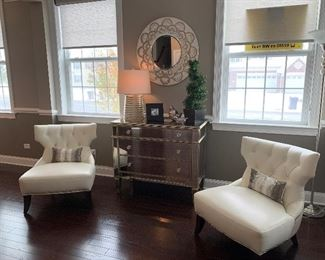2 Chippendale queen Ann style  tufted chairs with pillows, mirrored three drawer dresser, blown glass lamp, round half circle design hanging  mirror, floor lamp