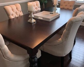 Beautiful dinning room table and six tufted upholstered arm chairs