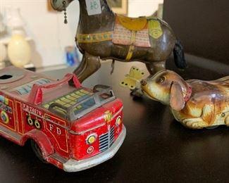 Antique horse, windup dog, fire truck