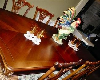 Table Top of the Dining set.  It has 8 Chairs, 2 leaves, and a full set of Table Pads.  Gorgeous and in excellent condition.