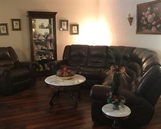 Black leather reclining pit group and oversized recliner- everything pictured goes