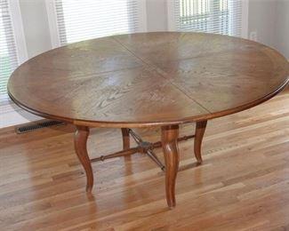 4. Circular Dining Room Table