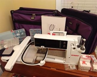 Bernina 880 plus. -$7500 - Carrying cases for machine and automated embroidery arm. Extra sets of specialized machine feet. Cases full of Bernina bobbins, thread, and accessories.