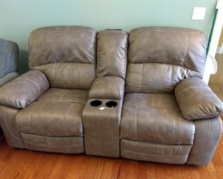 New love seat - $600 - motorized recliners and power