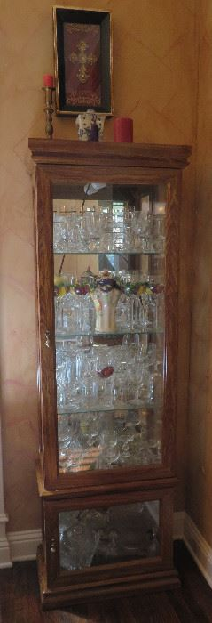 Lighted oak curio cabinet