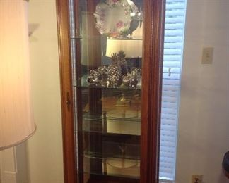 "Living Room:  The perfect display for your treasures!  This lighted curio has a mirror back, glass sides, beveled glass door, and four adjustable glass shelves.  It measures 28"" wide x 15"" deep x 78"" tall."