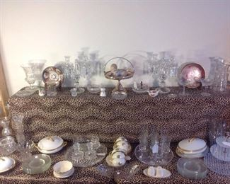 "Living Room:  Antique cut glass, vintage BACCARAT crystal sconces (closer photo coming soon), a porcelain piano baby resting in a silver-plate basket, pressed glass, a vintage ""coin"" glass set [oval bowl and pair of candlesticks], etched stems, china, clear plates, three tier crystal caddy, some LENOX, and more!"