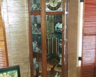 HUGE GRANDFATHER CLOCK WITH GLASS SHELVING, YOU GET THE WINDING KEY AND DOOR KEY AS WELL, REALLY NICE!