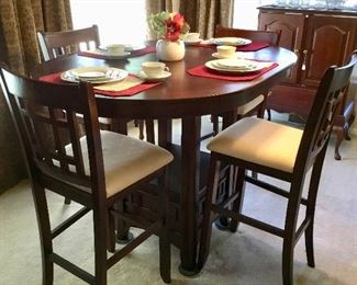 Like new pub drop leaf table with 4 chairs