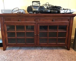 Hooker brand mahogany tv/entertainment stand w/ radio/CD player & other various electronic equipment.