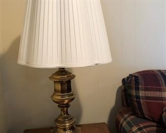 Another picture of one of two matching brass lamps w/ shades. Ceramic rabbit w/ small candle.