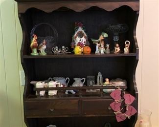 Small wooden hutch displaying antique salt & pepper shaker collection, crystal basket & tall dish, & other small household ornaments.