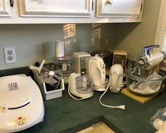 2 Electric hand mixers, stand mixer, 2 large food processors & one w/ several attachments. One small food processor & a George Foreman 2-serving classic plate electric grill.