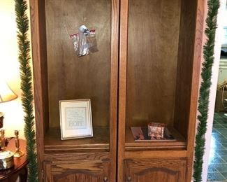 Two matching oak book shelves w/ lower cabinets.  Small framed print.