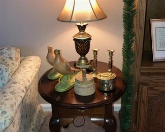 One of 2 matching oval end tables, small lamp w/ shade, 2 matching bird figurines,  antique wooden press, 2 brass candle sticks & brass incense container.