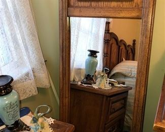 One of 2 mirrors that are part of the queen sized bedroom set.