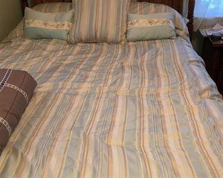 Queen size bed w/ mattress & headboard. Queen size bedding set.