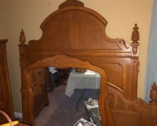 Oak queen size headboard & footboard w/ rails. Dresser mirror.