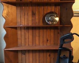 Knotted pine corner bookshelf, couple of planters,  Husky pressure washer & 1967 VW Beetle original hubcap.