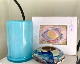 Original art, blown glass, and hand thrown pottery everywhere.