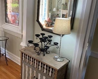 Mirror is made of metal with beveled glass...super cute storage cabinet