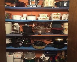 Kitchen items include Corning Ware, Pyrex, Calphalon pots and pans, Kitchen-Aid mixer