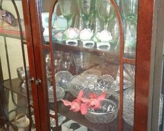 Crystal stem ware in china cabinet.