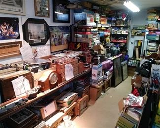 Huge selection of board games ( back middle and right ) record albums...Wall pictures and art....Camera items back middle