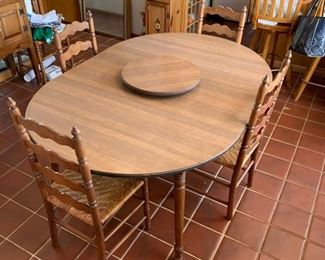 Great table with extra leaves and Lazy Susan.