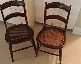 Two old cane bottom chairs