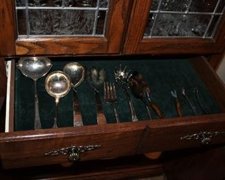 Sterling silver serving utensils.