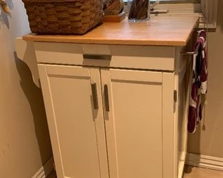 Kitchen island on wheels with the butcher block top