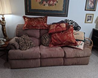 Double recliner couch, will to pre-sale before the sale..  Price for this piece is $100.00