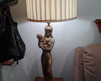 Very ornate lamp, of a women holding grapes / flowers