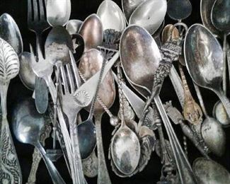 Collectible spoons...other bins and zipper bags full of cutlery