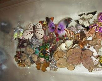 Butterfly pins and broaches