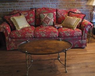 Plush red sofa and brass coffee table