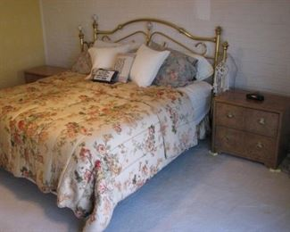 King bed with a brass headboard