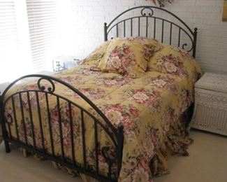 Full size bed with cast-iron frame headboard and footboard