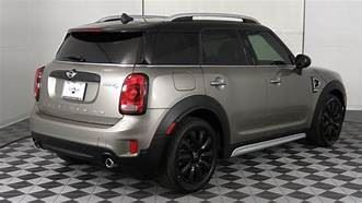 Mini Cooper Countryman 2018 S with some John Cooper custom steering wheel etc. styling - Vin # WMZYT3C30J3D99691 I will replace this with the actual car next week!  $29,400 has less than 5,000 miles.  THE PICTURE IS INCORRECT - it is actually silver with a white top - super snazzy!