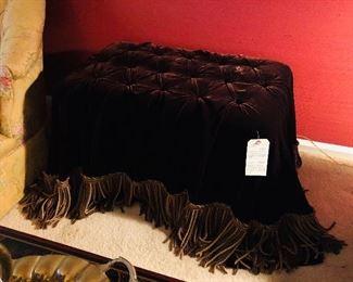 Custom made velvet ottoman, draped in dark brown velvet with long fringe