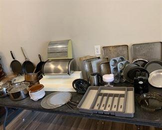 Kitchen Items: pots, pans, baking trays, muffin tins, silverware drawer (adjustable), splatter shields, electric frother, bread bin, antique wrap dispenser, mini crockpot