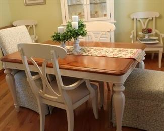 Dining  room  table and  six  chairs.  There  is  one  leaf for  the  table.