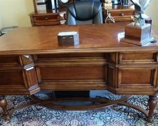 Beautiful  office  desk.  This  is 62  x  32.  It  matches  the  other  office  furniture. This  is  part  of  the  executive  office  furniture  and  can  be  purchased  early